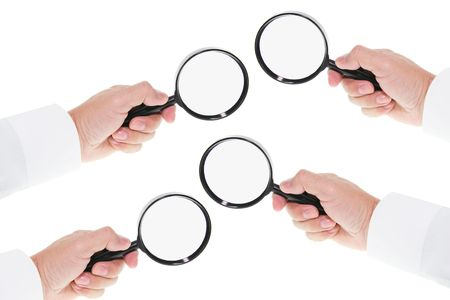 enlargement: Hands Holding  Magnifying Glass on Seamless White Background Stock Photo