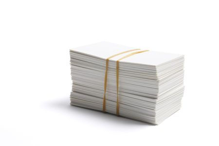 rubberband: Stack of Blank Name Cards on White Background Stock Photo