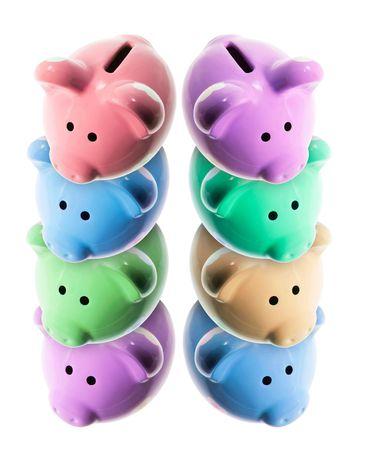 frugality: Piggy Banks on Isolated White Background Stock Photo