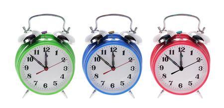 timely: Alarm Clocks on Isolated White Background Stock Photo