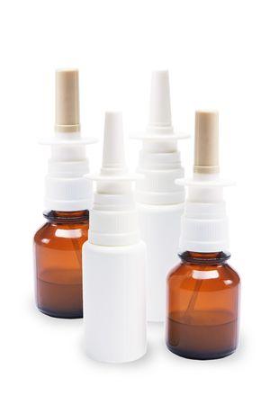 antihistamine: Bottles of Nasal Spray on  White Background