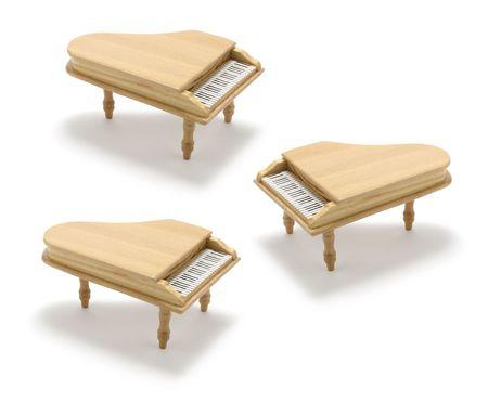 recital: Miniature Pianos on White Background