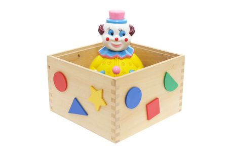 Toy Clown in Wooden Box on White Background photo