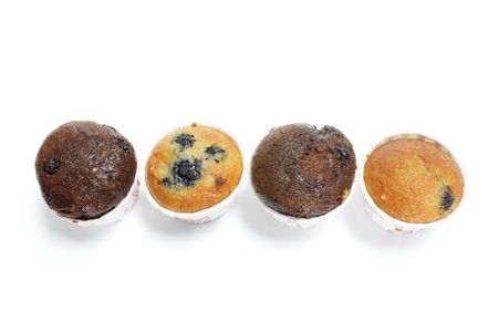 blueberry muffin: Row of Mini Muffins on White Background Stock Photo