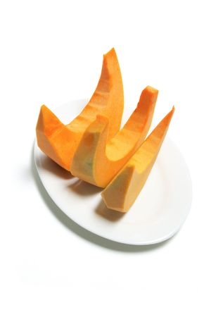 Plate of Pumpkin Slices on White Background photo
