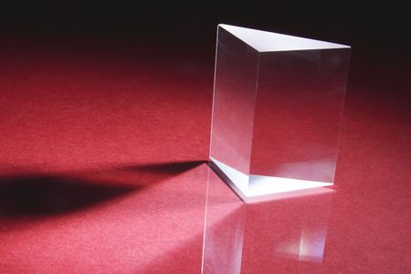 polarization: Glass Prism on Red Background
