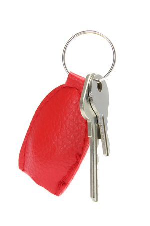 Keys with Leather Tag on White Background photo