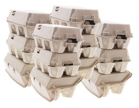 Stacks of Egg Cartons on White Background photo