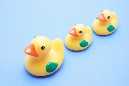 queueing: Rubber Ducks on Blue Background