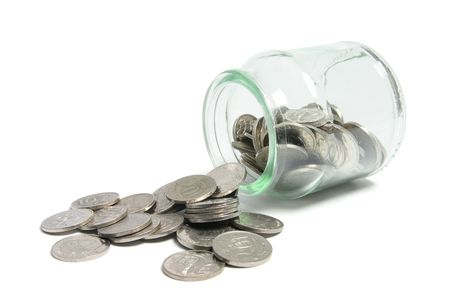 Coins in Glass Jar on Isolated White Background photo