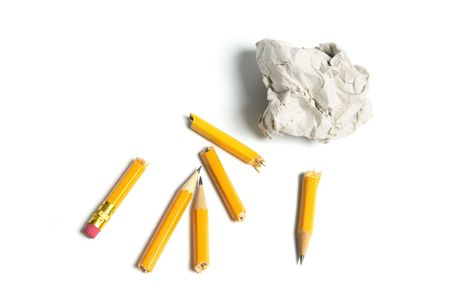Broken Pencils and Paper Ball on White Background