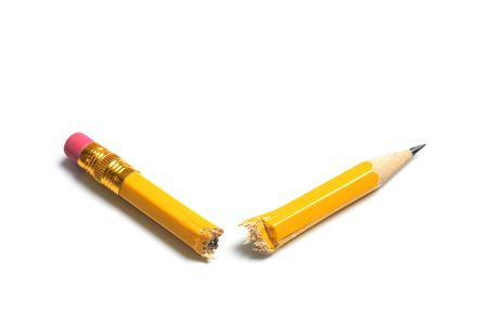 snapped: Broken Pencil on Isolated White Background