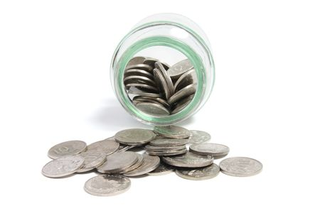 Coins in Glass Jar on White Background Stock Photo - 5537527