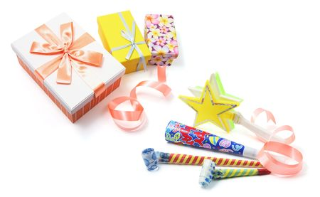 Gift Boxes and Party Items on White Background photo