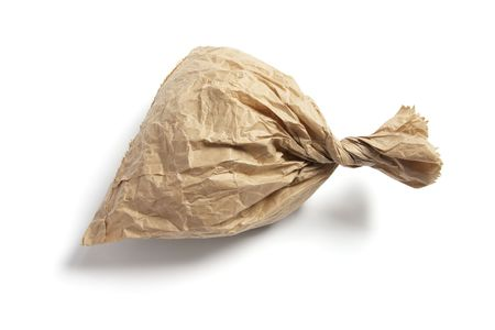 Crumpled Brown Paper Bag on White Background photo