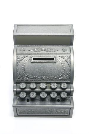 Toy Cash Register Saving Bank on White Background photo