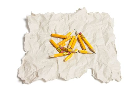 discarded: Broken Pencil Pieces and Waste Paper on White Background Stock Photo