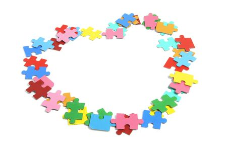 Jigsaw Puzzle Pieces  in Heart Shape photo