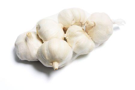 Garlic in Mesh Bag on White Background Stock Photo - 5721555