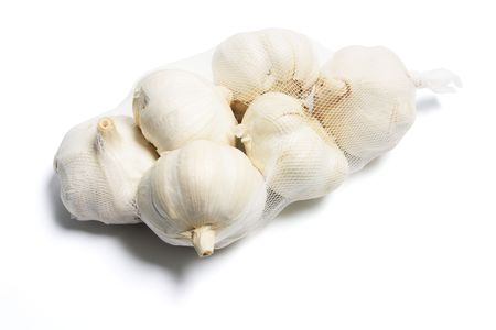 Garlic in Mesh Bag on White Background Stock Photo - 5721555