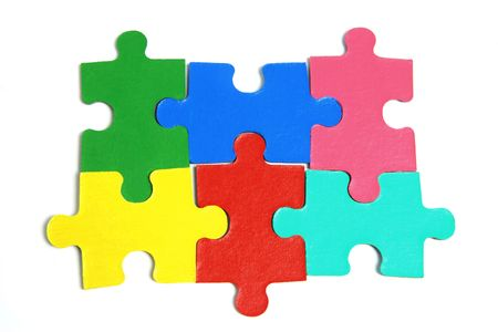 jigsaw pieces: Jigsaw Puzzle Pieces on White Background Stock Photo