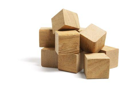 Pile of Wooden Blocks on White Background photo