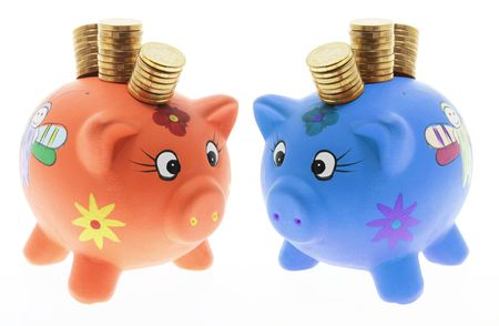Piggy Banks with Stacks of Coins on White Background photo