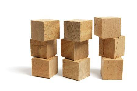 Stacks of Wooden Blocks on White Background photo