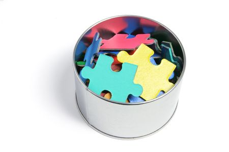 tidiness: Jigsaw Puzzle Pieces in Tin on White Background