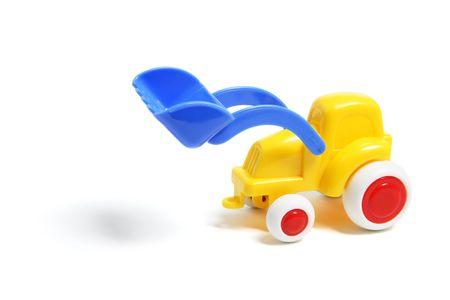 earthmover: Plastic Toy Earthmover on White Background