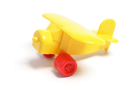 isolated on the white background: Plastic Toy Plane on Isolated White Background