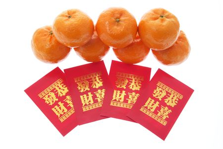 Mandarins and Red Packets on Isolated White Background photo