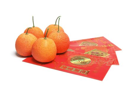 Red Envelopes and Tangerines on White Background photo