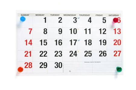 Calendar Page with Pushpins on White Background photo
