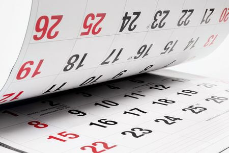 Close up of Calendar Pages on Seamless White Background photo