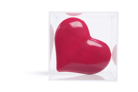 loveheart: Red Love Heart in Plastic Box on White Background Stock Photo