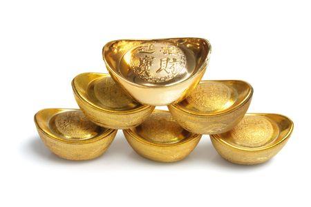 Stack of Chinese Gold Ingots on White Background photo