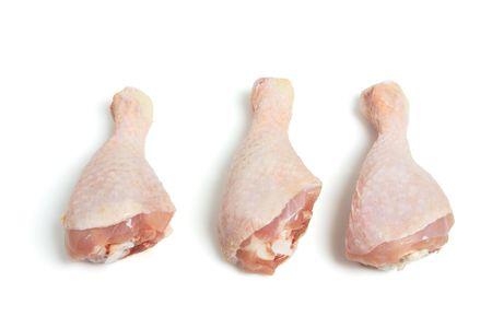 Raw Chicken Drumsticks on White Background photo