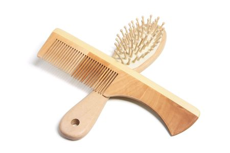 hairbrush: Comb and Hairbrush on White Background