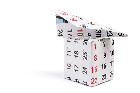 Calendar Paper Plane and Box on White Background photo