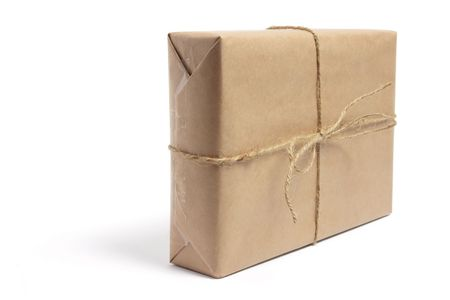 Brown Parcel on Isolated White Background photo