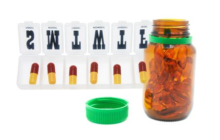 pill box: Pill Box and Fish Oil Capsules on White Background Stock Photo