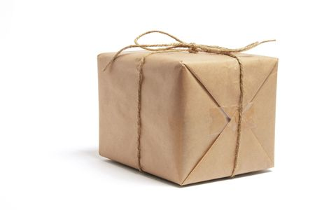 Brown Package Tied with String on White Background photo