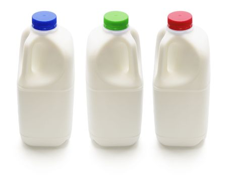 pasteurized: Bottles of Milk on Isolated White Background
