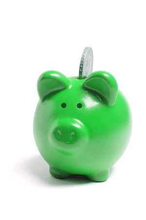 frugality: Piggybank with Coin on White Background