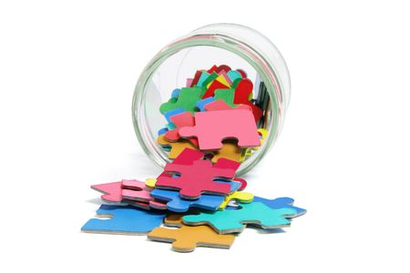 tidiness: Jigsaw Puzzle Pieces and Glass Jar on White Background Stock Photo