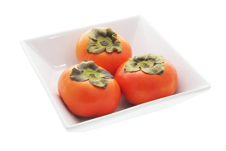 persimmons: Persimmons in Bowl on White Background