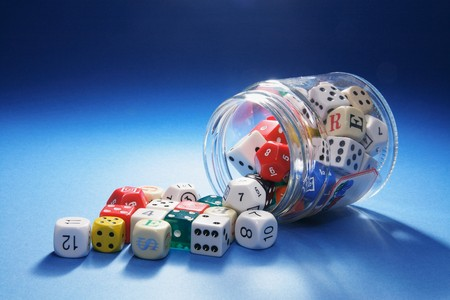 Collection of Dice in Glass Jar on Blue Background Stock Photo - 6946020