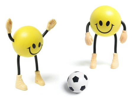 Smiley Toys and Football on White Background photo