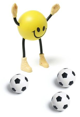 Smiley Toy and Football on White Background photo